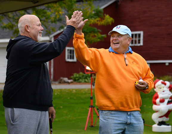 CARL RUSSO/Staff photo Jimmy Grant, right, in charge of the putting contest, congratulates Dave Accardi of Haverhill after he made a 30 foot putt on the first try. The putting contest was started four years ago to coincide with the hole in one contest. <br /> <br /> The annual Haverhill Gazette hole in one contest and putting contest to benefit the Gazette Santa fund began Wednesday at Garrison's Golf Center. The contest continues Thursday and Friday from 4 - 8 p.m., and Saturday from noon to 4 p.m. 10/9/2019