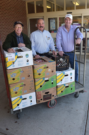 TIM JEAN/Staff photo<br /> <br /> Stuart McNeil, of Andover, left, and John Tierney, of North Andover, right, pick up food donations from the North Andover Stop & Shop with its store manager Dom Mondi. They pick up everyday for the store.    10/24/19