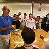 RYAN HUTTON/ Staff photo<br /> Woodbury Middle School STEM teacher Mickey Natoli, right, talks his students through the model wind turbines they built on Tuesday.