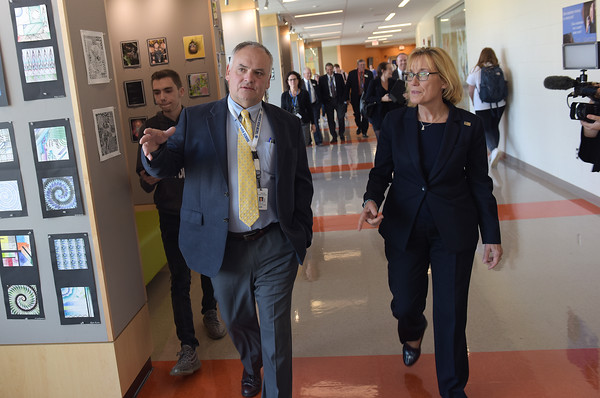 TIM JEAN/Staff photo<br /> <br /> Sen. Maggie Hassan, right, listens to Christopher Dodge, left, Director of the Salem's Career and Technical Education during a tour of the CTE areas at Salem High School.     10/4/19