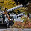 TIM JEAN/Staff photo<br /> <br /> Methuen tree department works clear a large tree as National Grid works to install a new utility pole on Vermont Street in Methuen. High winds and rain overnight caused major damage throughout the Merrimack Valley.     10/17/19