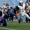 TIM JEAN/Staff photo<br /> <br /> Lawrence quarterback Jacob Tamayo, right, runs for a big gain as he avoids being tackled by Methuen linebacker Junior Gelin during the first half of a football game.   10/26/19