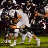 CARL RUSSO/Staff photo Windham's Riley Desmarais fumbles the ball on a tackle by Timberlane's Cooper Kelley, left and Reese Olsen, right.  Windham defeated Timberlane 17-14 in football action. 10/18/2019