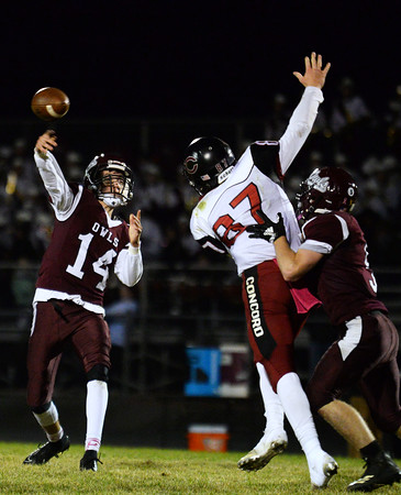 CARL RUSSO/Staff photo Timberlane's quarterback, Jared Morrison throws under pressure. Concord defeated Timberlane 28-14 in Friday night football action. 10/4/2019