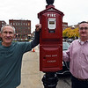 RYAN HUTTON/ Staff photo<br /> Team Haverhill members Karl Brunelle, left, and Kevin Burke, right, pose with pose with the alarm box out front of the Haverhill Post Office in Washington Square on Friday afternoon. Team Haverhill recently spent their time clearing cleaning and repainting the box along with general beautification efforts around the Post Office.