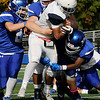 TIM JEAN/Staff photo<br /> <br /> Lawrence's Sergio Mendez runs for a big gain before being gang tackled by Methuen during a football game at Nicholson Stadium in Methuen.   10/26/19.