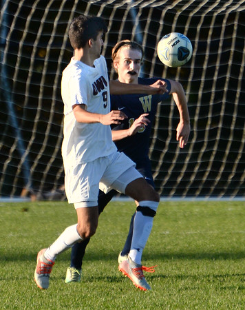 CARL RUSSO/Staff photo Windham's Aidan Peretz, right and Timberlane's Ross Cameron fight for the ball in boys soccer action. 10/15/2019