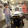 TIM JEAN/Staff photo<br /> <br /> Alexia Sanchez, 4, gives a thumbs-up after checking out the inside of an ambulance during the second annual Methuen Day in downtown Methuen in coordination with the Methuen Fire and Police Departments Open Houses.   10/5/19