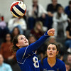 CARL RUSSO/Staff photo. Salem captain, Kacie Blanchet keeps the ball in play as captain Kristen Carney keeps her eye on the ball. Salem Blue Devils were defeated by the Bedford Bulldogs three games to one in volleyball tournament action Thursday night. 10/31/2019