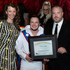 CARL RUSSO/Staff photo. Noah Venuti of American Training, aka ''The Human Cannon Ball'' presents one of three Outstanding Partners award to Mike and Victoria Magner, owners of Prides Deli in Beverly. Also receiving  the Outstanding Partners award was Activmed Practices and Research in Methuen. <br /> <br /> American Training celebrated its 40th Anniversary and presented Ray DiFiore of Methuen with the 2019 Life Matters Award during the 18th Annual Life Matters Awards Gala on October 25 at the Andover Country Club. DiFiore was honored with the Life Matters Award for his dedicated career in public service in Lawrence and Methuen, and his commitment to American Training. <br /> <br /> Several other people and businesses were also honored with awards for Outstanding Partners, Vendor of the Year and Company of the Year. <br /> <br /> American Training is a non-profit organization based in the Merrimack Valley that provides housing, education, training & support services to people with disabilities, youth at risk & adult learners who are looking for a pathway towards a more meaningful life. 10/25/2019