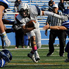 TIM JEAN/Staff photo<br /> <br /> Lawrence's Vinny Schmidt breaks tackles and runs for a short gain against Methuen during the first half of a football game.    10/26/19