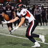 CARL RUSSO/Staff photo North Andover's Max Wolfgang breaks up the play by knocking the ball away from the Chelmsford player, but is unable to take possession after chasing and juggling the live ball. North Andover defeated Chelmsford 22-20 in Friday night football action.  10/11/2019