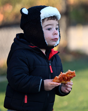 CARL RUSSO/Staff photo Paul Tanglis, 2 enjoys pizza and football at a recent North Andover Scarlet Knights' game. North Andover defeated Dracut 41-14 in football action late Friday afternoon. 10/18/2019