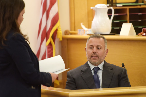 TIM JEAN/Staff photo<br /> <br /> Prosecutor Jennifer Haggar, left, asks Seabrook Police Sgt. David Buccheri questions as he testifies on the witness stand during the bench trial of Dawn Marie Barcellona, in Rockingham County Superior Court in Brentwood, NH. 10/9/19