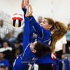 CARL RUSSO/Staff photo. Salem's Kylie Greeley, left and Ecaterina Rojco struggle to knock the ball back over the net.  Salem Blue Devils were defeated by the Bedford Bulldogs three games to one in volleyball tournament action Thursday night. 10/31/2019