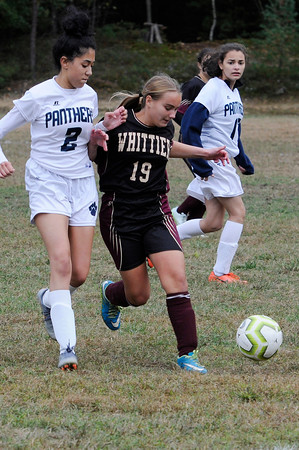 TIM JEAN/Staff photo<br /> <br /> PMA's Diana Cavveno, left, and Whittier's Nataue Vienean battle for the ball during a girls soccer game. Whittier Tech defeated Presentation of Mary Academy 3-0.    10/3/19