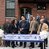RYAN HUTTON/ Staff photo <br /> Surrounded by state and local officials, Lawrence Mayor Daniel Rivera, center, cuts the ribbon on the newly renovated Arlington Point apartments on Broadway in Lawrence at the site of the old Van Brodie Mill building on Tuesday.