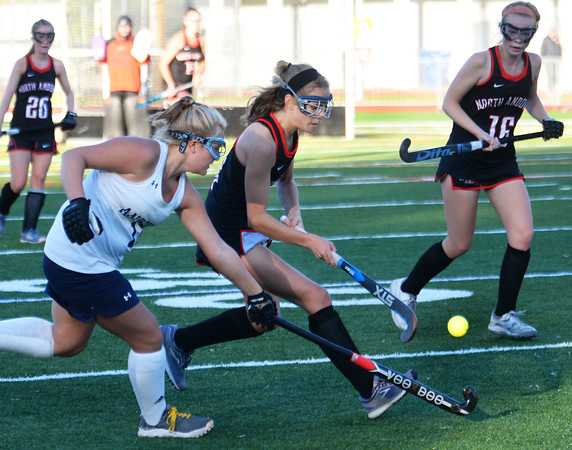 CARL RUSSO/Staff photo Andover's Abby Miller, left and North Andover's Lexi Swartz fight for the ball. Andover and North Andover battled to a 1-1 tie in field hockey action Wednesday afternoon.10/23/2019
