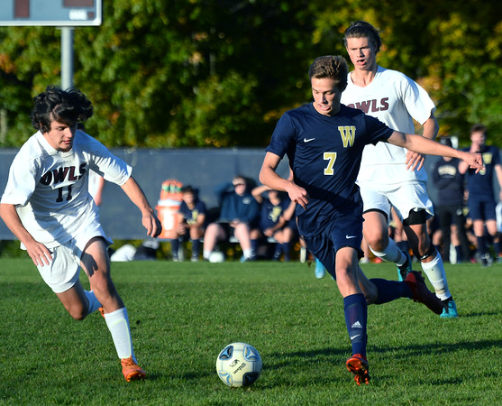 CARL RUSSO/Staff photo Windham's Landon Neal races up field with the ball against Timberlane's Trevor Baggett  in boys soccer action. 10/15/2019