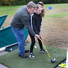 CARL RUSSO/Staff photo Mike McGonagle of Haverhill gives his granddaughter, Lilly McGonagle, 12, some tips as she participates in the hole in one contest. <br /> <br /> The annual Haverhill Gazette hole in one contest and putting contest to benefit the Gazette Santa fund began Wednesday at Garrison's Golf Center. The contest continues Thursday and Friday from 4 - 8 p.m., and Saturday from noon to 4 p.m. 10/9/2019