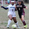 TIM JEAN/Staff photo<br /> <br /> PMA's Chanelle Hiche, left, and Whittier's Tatum Colgate battle for the ball during a girls soccer game. Whittier Tech defeated Presentation of Mary Academy 3-0.    10/3/19