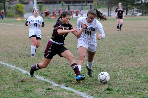 TIM JEAN/Staff photo<br /> <br /> Whittier's Bella To battles to control the ball against PMA's Gabriela Martinez during a girls soccer game. Whittier Tech defeated Presentation of Mary Academy 3-0. 10/3/19