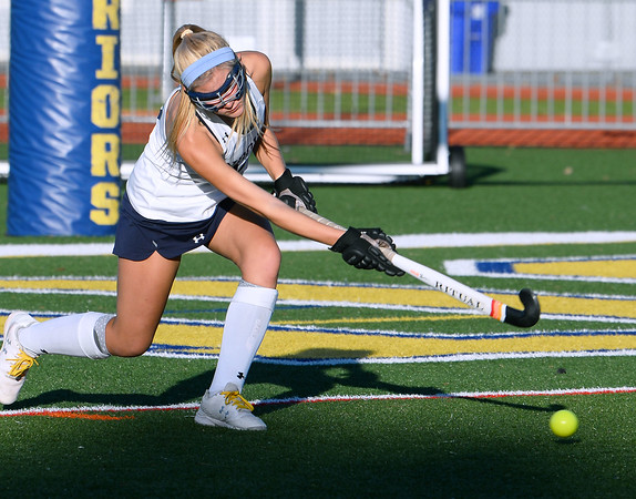 CARL RUSSO/Staff photo Andover's Hailey Doherty puts the ball into play. Andover and North Andover battled to a 1-1 tie in field hockey action Wednesday afternoon.10/23/2019