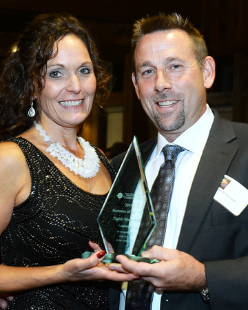 CARL RUSSO/Staff photo  Business of Year award recipient Scott and Julie Hayward, owners of Tupelo Music Hall. The award is sponsored by DeFrancesco's Southern NH Quality Roofing and General Contracting. <br /> <br /> The Greater Derry and Londonderry Chamber of Commerce held their 2019 annual award dinner Thursday night at the Birch wood vineyards.  10/03/2019