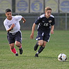 MIKE SPRINGER/Staff photo<br /> Lawrence's Samuel De Amorin, left, keeps up with Ryan O'Sullivan of Andover during varsity soccer action Tuesday at Andover.<br /> 10/01/2019