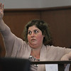 MIKE SPRINGER/Staff photo<br /> Tania Gonzalez, who was displaced from her South Lawrence home for four months following the September, 2018, gas disaster, raises her hand to speak during a hearing Monday in Salem Superior Court concerning the proposed $143 million settlement with Columbia Gas. Gonzalez thinks the settlement is not enough.<br /> 10/07/2019