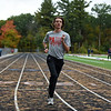 RYAN HUTTON/ Staff photo<br /> Pinkerton Academy cross country runner Stephen Connelly warms up on the school's track on Wednesday.