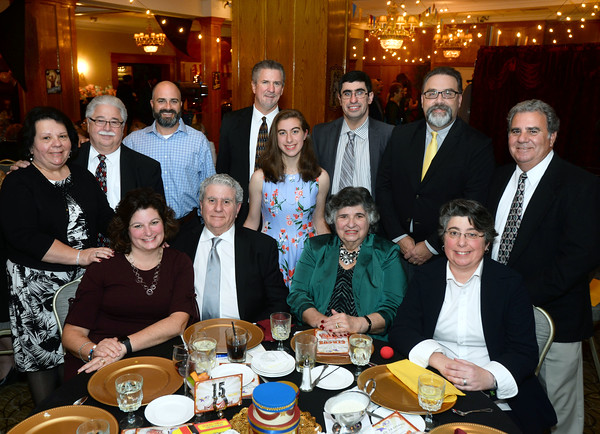CARL RUSSO/Staff photo. The 2019 Life Matters Award recipient, Ray DiFiore, seated, second from the left, is surrounded by his family. First row: Rose Maria Redman of Methuen; Ray and Kay DiFiore of Methuen and Cathy Walsh of Methuen. Standing from left: Karen and Dennis Winning of Salem N.H., Dana DiFiore Jr. of Andover; Kevin Redman of Methuen; Jamie Walsh, 18, of Methuen; Ray-J DiFiore of Methuen; Michael Walsh of Methuen and Dana DiFiore Sr. of Melvin Village N.H.   <br /> <br /> American Training celebrated its 40th Anniversary and presented Ray DiFiore of Methuen with the 2019 Life Matters Award during the 18th Annual Life Matters Awards Gala and Greatest Show On Earth circus theme celebration on October 25 at the Andover Country Club. DiFiore was honored with the Life Matters Award for his dedicated career in public service in Lawrence and Methuen, and his commitment to American Training. <br /> <br /> Several other people and businesses were also honored with awards for Outstanding Partners, Vendor of the Year and Company of the Year. <br /> <br /> American Training is a non-profit organization based in the Merrimack Valley that provides housing, education, training & support services to people with disabilities, youth at risk & adult learners who are looking for a pathway towards a more meaningful life. 10/25/2019