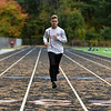 RYAN HUTTON/ Staff photo<br /> Pinkerton Academy cross country runner Luke Brennan, warms up on the school's track on Wednesday.