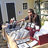 TIM JEAN/Staff photo<br /> <br /> Artist Dominique Lecomte, right, of Methuen and owner of Idartwork helps a customer on the last day of the season for Andover's Farmers Market.  10/19/19
