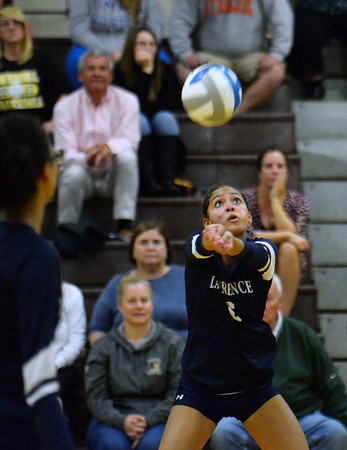 CARL RUSSO/Staff photo Lawrence's Maria Reyes keeps the ball in play.  Haverhill defeated Lawrence in volleyball action wednesday evening. 10/9/2019