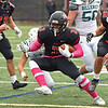 RYAN HUTTON/ Staff photo<br /> North Andover's Ricky Brutus dashes through a break in the defensive line during the first half of Friday's home game against Billerica.
