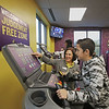 MIKE SPRINGER/Staff photo<br /> Ten-year-old AJ Cardona tries out the treadmill machine as Beth Lebreton, a trainer at Planet Fitness Manchester, shows him how to operate it Thursday during the grand opening of the new Judgement Free Zone exercise room at the Boys and Girls Club in Salem.<br /> 10/17/2019
