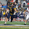 TIM JEAN/Staff photo<br /> <br /> Andover's Michael Slayton, left, runs after making a catch as Central's Kevin Higgins tries to tackle him during a football game at Andover High School.    10/5/19