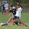MIKE SPRINGER/Staff photo<br /> Lawrence's Jesus Guzman, right, kicks the all away from Allen Gao of Andover during varsity soccer action Tuesday at Andover.<br /> 10/01/2019