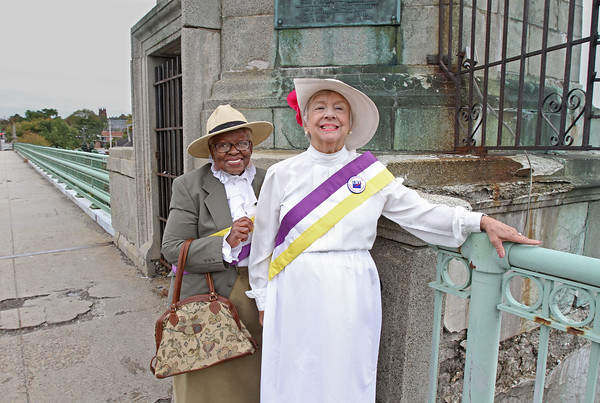 MIKE SPRINGER/Staff photo<br /> Kalister M. Green-Byrd, left, and Kay Herlihy stand on the Haverhill Bridge over the Merrimack River. They are organizing an Oct. 20 reenactment of a 1914 women's suffrage march across the bridge.<br /> 10/08/2019