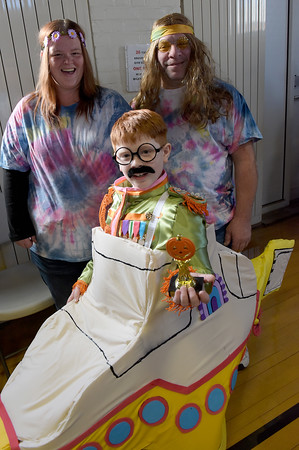 TIM JEAN/Staff photo<br /> <br /> Justin Marchese, 8, of Derry, and his family Alexis Courtois, and Patrick Marchese won the judges choice with their Beatles costume during the Spooktacular Costume Parade & Contest in Veterans Hall Gymnasium.   10/26/19