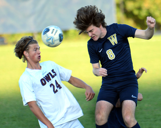 CARL RUSSO/Staff photo Windham's Ryan Pascarella, right and Timberlane's Jacob Stewart fight for the ball in boys soccer action. 10/15/2019