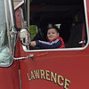 TIM JEAN/Staff photo<br /> <br /> Victor F. Martinez, 5, of Lawrence, pretends to drive one of the fire trucks during the Lawrence Fire Department open house Saturday morning.   10/12/19