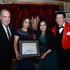 CARL RUSSO/Staff photo. Joe Robichaud, left, Job Developer for American Training and Thomas Connors, President and CEO of American Training presented one of three Outstanding Partners award to Hans Kissle Company in Haverhill. Accepting for the company are Claudia Coronado, left of Methuen, production manager and Amiriz Serrano of Lawrence, production supervisor. Also receiving  the Outstanding Partners award was Activmed Practices and Research in Methuen. <br />    <br /> American Training celebrated its 40th Anniversary and presented Ray DiFiore of Methuen with the 2019 Life Matters Award during the 18th Annual Life Matters Awards Gala on October 25 at the Andover Country Club. DiFiore was honored with the Life Matters Award for his dedicated career in public service in Lawrence and Methuen, and his commitment to American Training. <br /> <br /> Several other people and businesses were also honored with awards for Outstanding Partners, Vendor of the Year and Company of the Year. <br /> <br /> American Training is a non-profit organization based in the Merrimack Valley that provides housing, education, training & support services to people with disabilities, youth at risk & adult learners who are looking for a pathway towards a more meaningful life. 10/25/2019