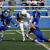 TIM JEAN/Staff photo<br /> <br /> Lawrence's Isaias Richards fights for more yards after a catch against Methuen.     10/26/19