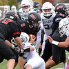 RYAN HUTTON/ Staff photo<br /> North Andover's Will Schimoeller pushes through a scrum of players during the first half of Friday's home game against Billerica.