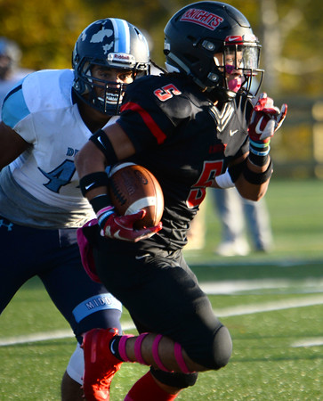 CARL RUSSO/Staff photo North Andover captain, Freddy Gabin sprints towards the end zone for a touchdown. North Andover defeated Dracut 41-14 in football action.10/18/2019