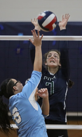 MIKE SPRINGER/Staff photo<br /> Sara D'Agostino, right, of Presentation of Mary blocks a shot by Celine Koeleman of Nashoba Valley Tech during varsity volleyball play Thursday in Methuen.<br /> 10/24/2019