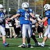 TIM JEAN/Staff photo<br /> <br /> Salem's Noah Poulin (53) celebrates with his teammates Andrew Sullivan (65) Jackson Dailey (59) and Tanner Morgano (61) after making an interception against Bedford. Salem defeated Bedford 34-3 at Trinity Stadium in Haverhill.   10/19/19
