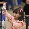 MIKE SPRINGER/Staff photo<br /> Three-year-old Miranda Grissom, a pre-school student, has fun launching a rocket she made during the Family STEM (Science, Technology, Engineering and Mathematics) Night on Thursday at St. Michael School in North Andover.<br /> 10/03/2019